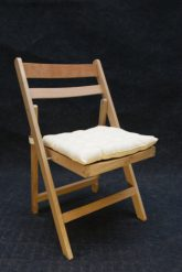 Wooden folding chair with cream seat pad