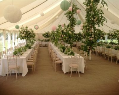 Coir carpet and trestles in canvas marquee