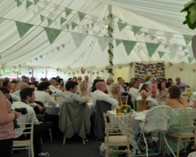 Guests in a traditional style marquee with bunting
