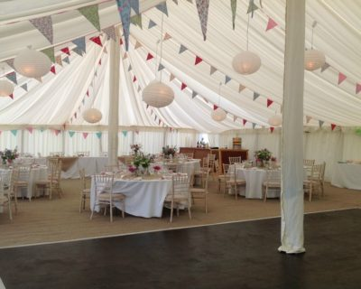 Interior of traditional style marquee with bunting
