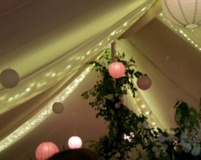 coloured lanterns inside marquee
