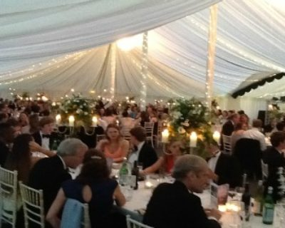 dinner guests inside marquee