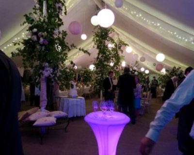 marquee with coloured possuer tables