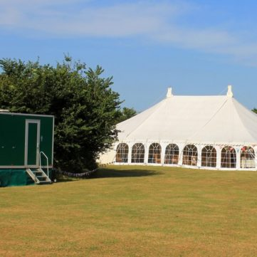 Marquee with luxury toilet trailer
