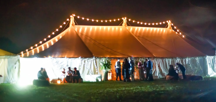 Traditional marquee with exterior string lighting