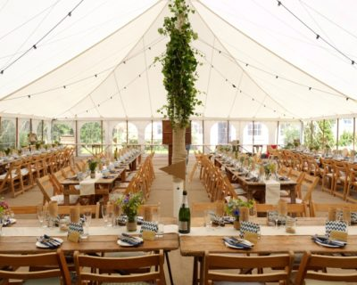 traditional marquee with rustic furniture