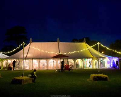 Marquee with fairy lights at night Martin Dabek Photography