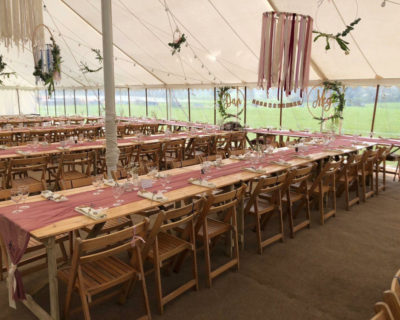 Rustic Trestle tables and wooden folding chairs