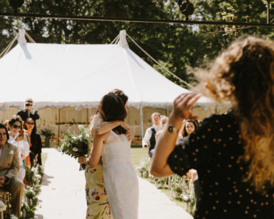 ceremony outside wedding marquee by Chris Bradshaw Photography