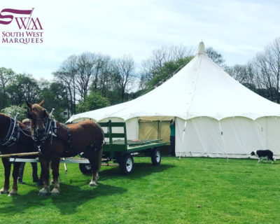 traditional canvas marquee with shire horses