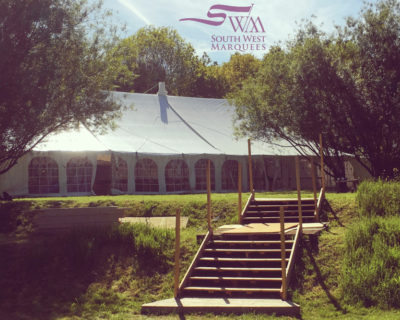 traditional marquee in sunny garden