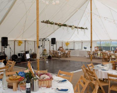 traditional marquee with wooden centre poles