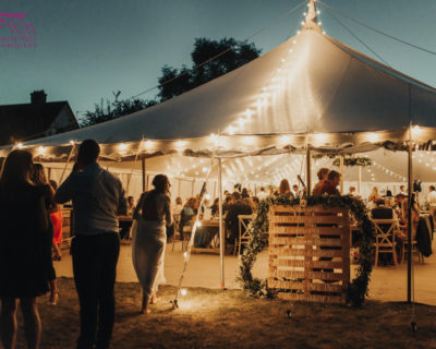 traditional wedding marquee with lights at night