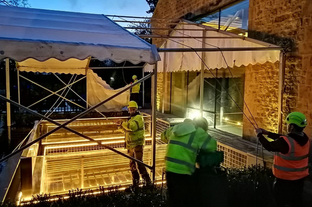 Assembling The Marquee Through The Night