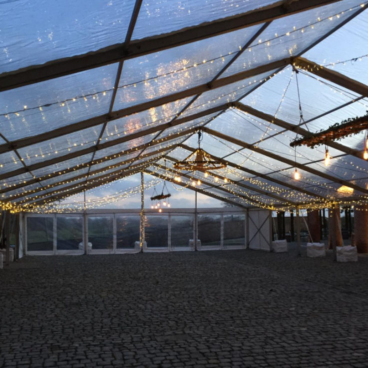 statement lighting in glass roofed marquee